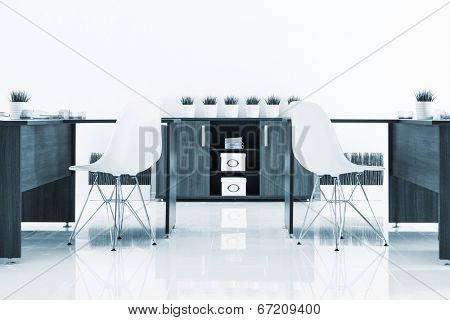 desks and plastic chairs with reflection on white wall