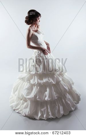 Beautiful Bride In Gorgeous Wedding Dress. Fashion Lady. Studio Photo