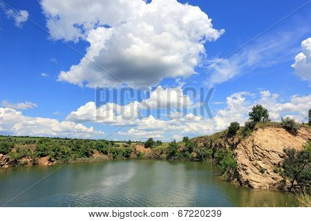 lake in old opencast mine place in summer day