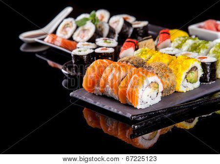 Various kind of sushi food served on black background