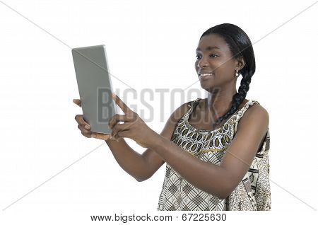 African Woman In Traditional Clothing With Tablet Pc