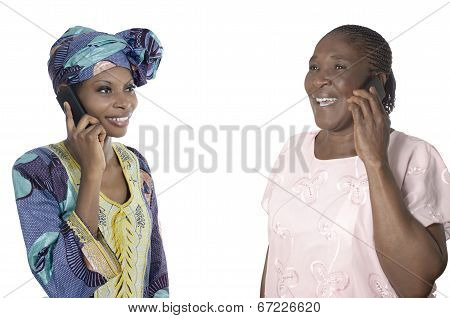 African Mother And Daughter Talking On Smart Phone