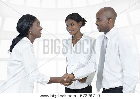 Three African Business Partners Shake Hands