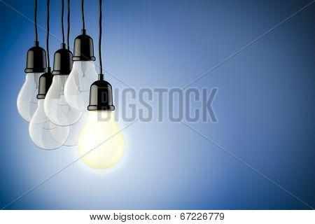 3d light bulbs on blue background