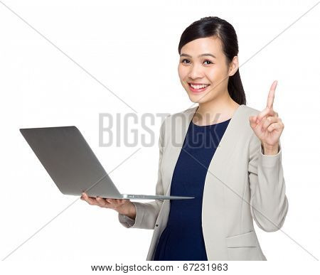 Business woman with notebook computer and finger point up