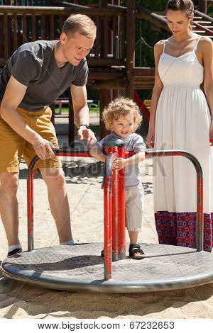 Little Boy On Merry-go-round