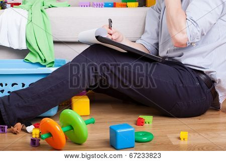 Young Father Working At Home