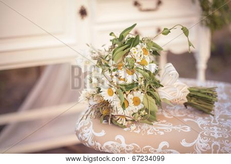 Cute Wild Flowers Engagement Flowers Bouquet On A Vintage Chair In A Shabby Chic Decor