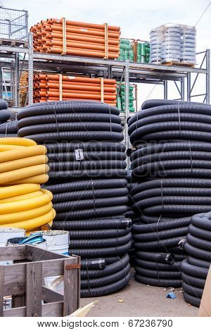 Rolls Of Plastic Pipes In A Warehouse Yard