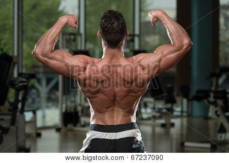 Bodybuilder Performing Rear Double Biceps Pose