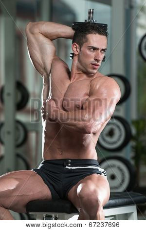 Young Man Exercise With Dumbbells