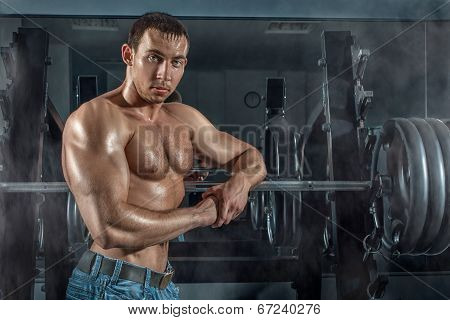 Bodybuilder Leaned On The Machine.