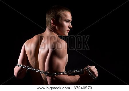 Handsome And Muscular Young Guy With Chain.