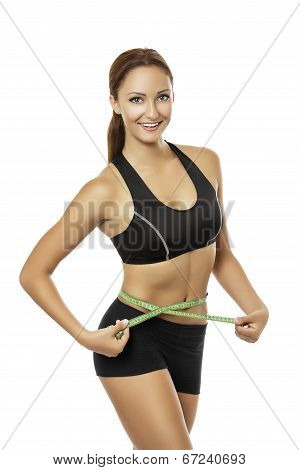 Athletic Woman Measuring Her Waistline