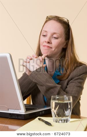 Satisfied Woman At Laptop