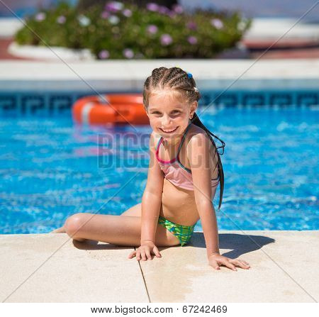 smiling cute little girl swims with a lifeline in the pool