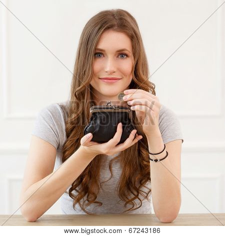 Cute, beautiful woman with wallet