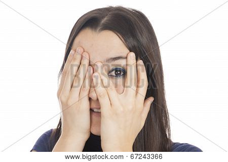 Woman Peeking Behind Her Hand