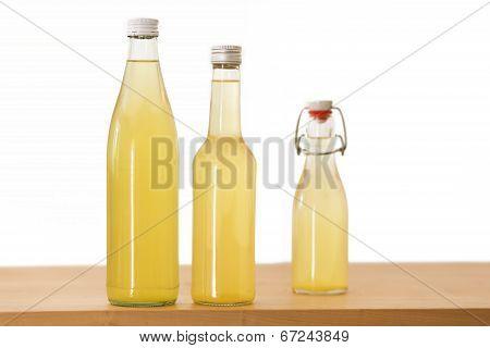 Bottles filled with elderflower syrup