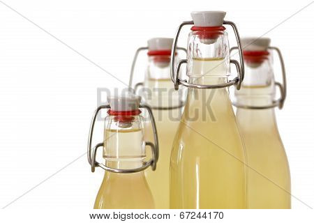 Bottles filled with elderflower syrup, shallow DOF