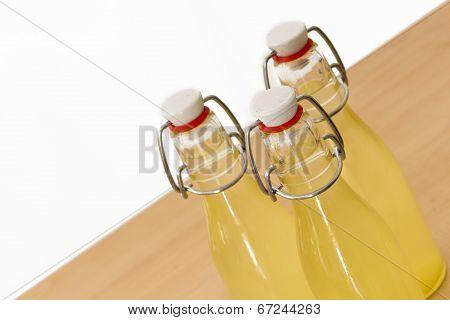 Bottles filled with elderflower syrup, large DOF