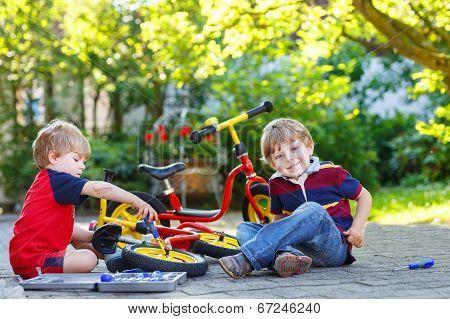 Two Little Brothers Repairing Broken Bike
