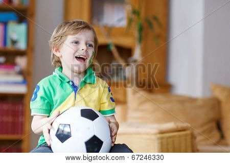 Active Boy Of 4 Watching Soccer Game