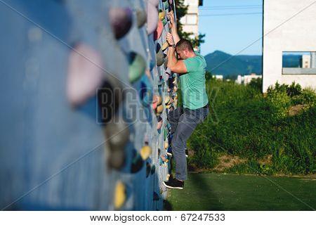 Young Man Climbing Wall Rock Outdoors