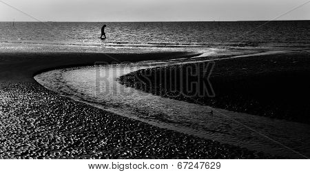 Lonely Man Walking At Seaside