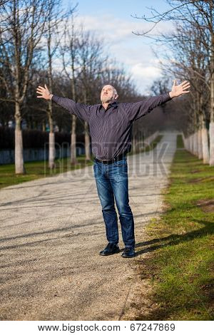 Middle-aged Man Enjoying The Sunshine