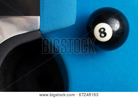 8 Ball Resting Near The Pocket