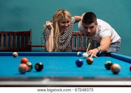 Couple Playing Billiard