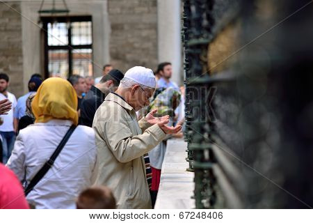 People Praying In Front Of The Tomb,