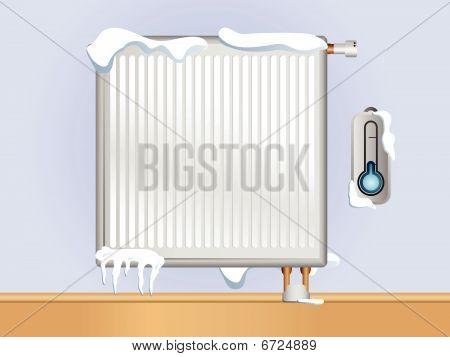 Broken Heizkörper mit Schnee und Eis.