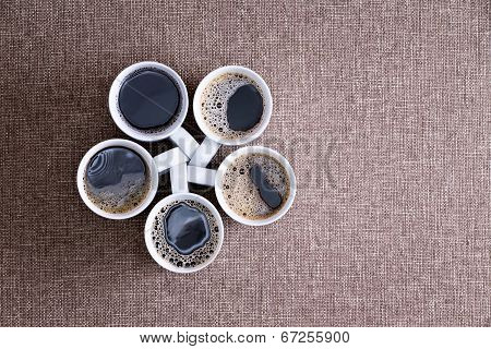 Five Mugs Full Of Black Coffee Ready To Be Served
