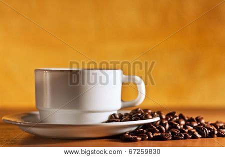 Coffee Cup And Saucer With Coffee Beans Still Life