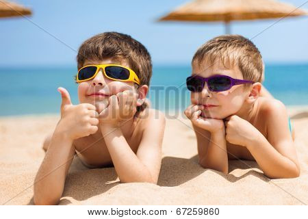 Portrait of two children on the beach
