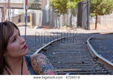 Woman model on railroad tracks