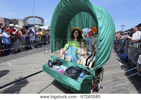 Family in covered wagon cart