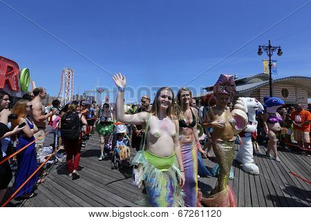 Young women in aquatic costumes