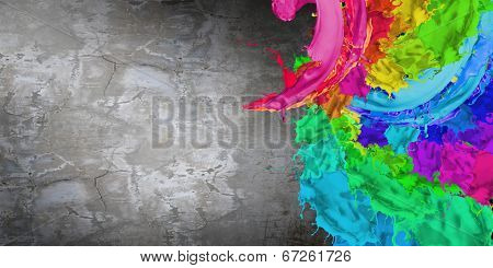 Cement wall painted with colorful splashes. Renovation concept
