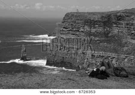 Scenic Seascape With Tourist On West Coast Of Ireland