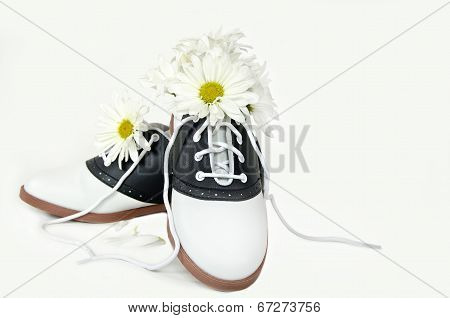 daisy bouquet in saddle shoe