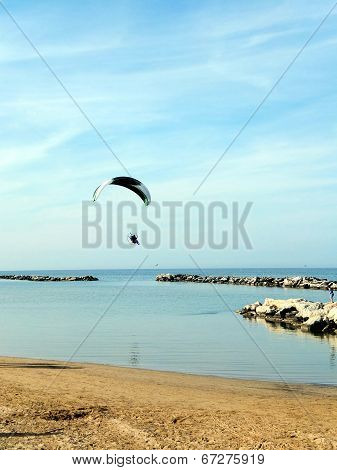 Para Glider Flying Along The Coast