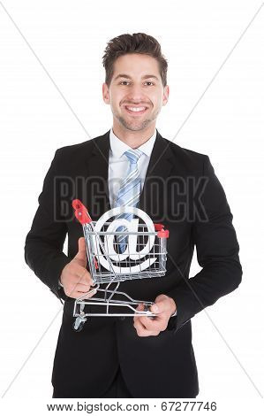 Businessman With Pushcart And Internet Symbol