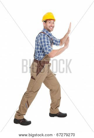Happy Manual Worker Pushing Billboard