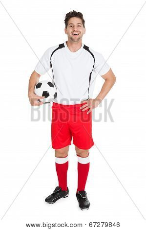 Soccer Player Holding Football