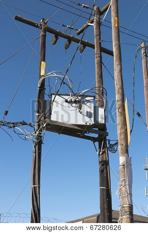 Wooden Poles And Platform Supporting Electricity Junction Box