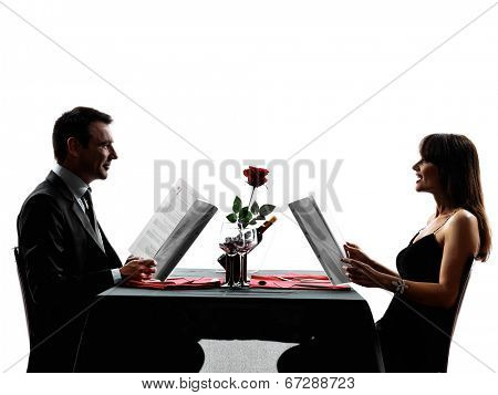 couples lovers dinning reading menu in silhouettes on white background