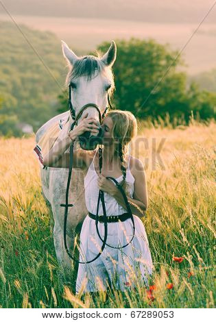 blonde long hair woman kissing beautiful horse